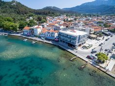 Hotel Angelica at old harbour of Limenas, the capital of Thassos island. Greece Hotels, Aerial View, Exterior, Island, Islands, Outdoor Rooms