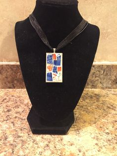 A personal favorite from my Etsy shop https://www.etsy.com/listing/459720844/necklace-pendant-mosaic-pendant-necklace
