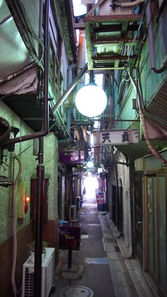 Street lamps lighting a back alley somewhere in Asia. <3