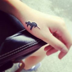 Adorable unicorn hand tattoo