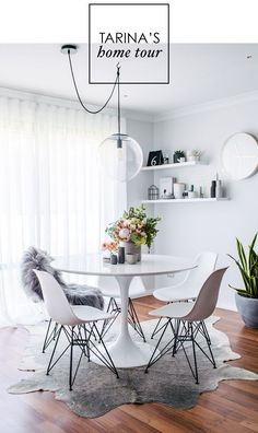 modern white and grey dining room area with round white table and white chairs Dining Room Design Area chairs Dining Grey modern Room Table white Saarinen Tisch, Mesa Saarinen, Saarinen Table, Dining Room Design, Dining Room Table, Dining Sets, Dining Area, Scandi Home, Scandinavian Interiors