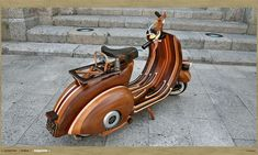 A handmade, bent-plywood body for a Vespa. Jeez.