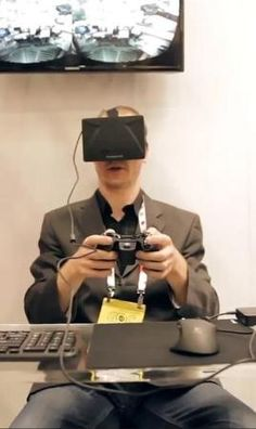A gamer playing with Oculus Rift, an immersive virtual reality video game display.