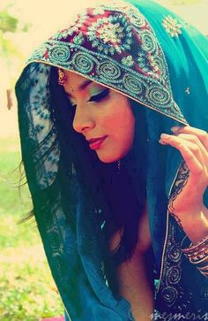Love her complexion and the colors of her scarf that match her eye shadow.