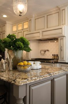 Cabinets Sherwin Williams - Antique White with a dark umber glaze, Island color in Sparrow by Ben Moore and Talisman Granite countertops