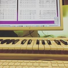 In case you're wondering wear I've been [img descr: a computer keyboard and a piano keyboard in front of a computer monitor with sheet music on it]