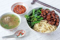 Mie ayam is one of the most popular noodle dishes in Indonesia, it is a type of a deconstructed chicken noodle soup where yellow wheat noodles (bakmi) is served separately from the soup. If you look closely at the photo above each element the of dish is quite visible as they are separated from each other from the seasoned chicken, boiled vegetables and the sambal (sauce).