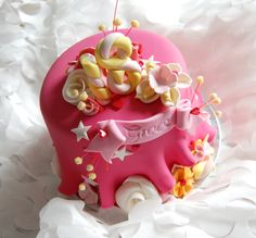 Pink 18th flump and flowers cake