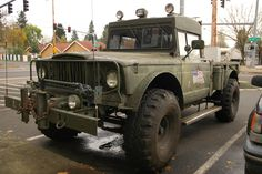 OLD PARKED CARS.: 1968 Jeep Military Gladiator.