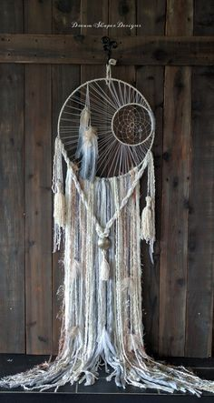 Cynthis Whitehawk is the artist and maker of this beautiful Dream Catcher.