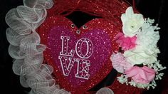 """This 18"""" Valentine's Day vine wreath has white mesh ribbon,pink and white artificial flowers and a message of love with 3 stones representing the past, present and future. Your front will shine with love in the sunshine.   Shop this product here: http://spreesy.com/Varnerscrafts/20   Shop all of our products at http://spreesy.com/Varnerscrafts      Pinterest selling powered by Spreesy.com"""