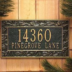 Pine Cone Address Plaque - GREEN/GOLD LETTERS - Improvements by Improvements. $94.99. Raised lettering on the house number plaque makes finding your address that much easier. Rust-free aluminum for long life. An elegant way to communicate your address. Address plaque allows for your house number and street name. An elegant way to communicate your address. Raised lettering on the house number plaque makes finding your address that much easier. Address plaque allows for yo...