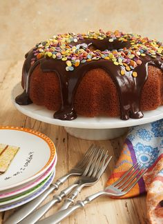 Yellow Bundt Cake with Dark Chocolate Ganache is one of my favorite celebration cakes, thanks to its crowd-pleasing flavors and ease of preparation. Just add sprinkles! - Bake or Break ~ http://www.bakeorbreak.com