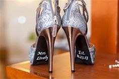 These silver sparkling wedding heels are hot! I love her new name on the bottom with their wedding date