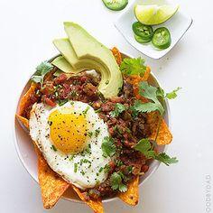 Doritos, refried black beans, salsa, avocado and a sunny side-up... DELISH!