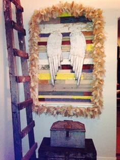 Take a modern art niche and turn it vintage. I collected old wood and cut it to size, added the wings and trimmed it out with a home made burlap garland. Easy DIY, though it does take patience and some time.