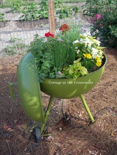 Repurposed old grill. Creative ways to add color and joy to a garden, porch, or yard with DIY Yard Art and Garden Ideas! Repurposed ideas for the backyard. Fun ideas for flower gardens made from logs, bikes, toys, tires and other old junk. ~ featured at LivingLocurto.com