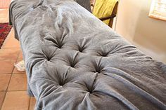 Very good pictures on how to make a tufted headboard. This could be used to make a banquette! http://www.flickr.com/photos/18682827@N00/