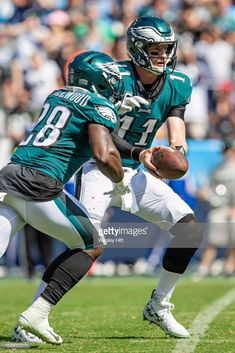Carson Wentz hands off the ball to Wendell Smallwood of the Philadelphia Eagles during a game against the Tennessee Titans at Nissan Stadium on September 2018 in Nashville, Tennessee. Get premium, high resolution news photos at Getty Images Football Photos, Nfl Football, Football Players, Nissan Stadium, Eagles Fans, Nfl Philadelphia Eagles, Fly Eagles Fly, Carson Wentz, Football Conference