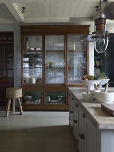 Peonies and Brass: old-school china cabinets in the kitchen