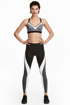 6d804c9b201019 Sports tights in fast-drying functional fabric with wide ribbing to hold in  and shape the waist. Concealed mesh key pocket in the waistband.