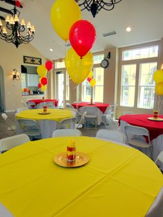 Alternated red and yellow table cloth overlays. Centerpieces were red and yellow balloons tied to Dollar Tree hurricane vases filled with lemonheads and cherry bombs. USC Graduation Party                                                                                                                                                     More