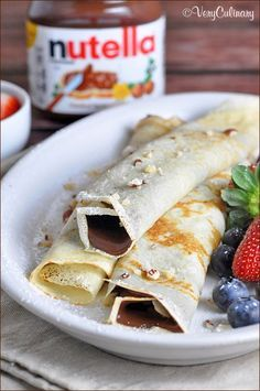 Nutella Stuffed Pancake Rolls (10 Great Pancake Recipes To Make This Weekend!)- Crepe-like pancakes filled with Nutella and fruit, then rolled up and sprinkled with powdered sugar,