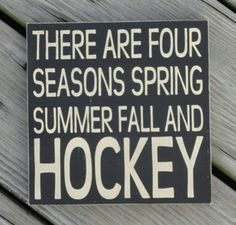 Four seasons, Spring, Summer, Fall and Hockey.  Hockey Sign