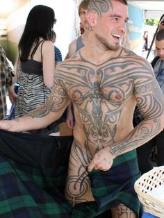 . this man, kilts, hot, logan mccree, celtic tattoos, tattooed guys, men, eye, ink
