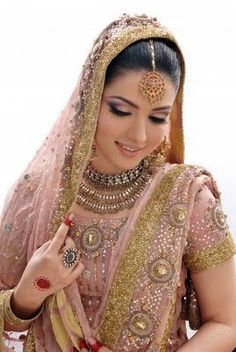 Another gorgeous bride with elegant bridal make up. The eye make up is inspired from embroidery work on brides dress and compliments the Bridal Jewelry. Asian Bridal Dresses, Eid Dresses, New Wedding Dresses, Indian Dresses, Dresses 2014, Indian Clothes, Pakistani Dresses, Indian Outfits, Asian Bridal Jewellery