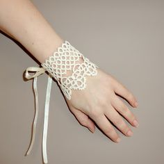 Bridal handmade lace cuff for your wedding in ivory (cream, beige, ecru ) Corset style lacing up tatted lace bracelet made in lace-making technique called tatting I shuttle tatted this glamorous cuff myself using my original pattern Cuff is inches . Tatting Armband, Tatting Bracelet, Lace Bracelet, Tatting Jewelry, Lace Jewelry, Bracelets, Needle Tatting, Tatting Lace, Lace Cuffs
