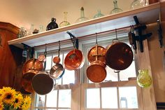 Repurposed copper pipe and shelf brackets -- now a pot rack. This one is an easy DIY.