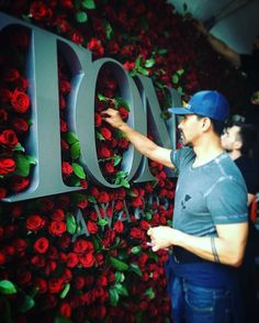Raul Àvila sets up the rose wall in preparation for the 2016 Tony Awards