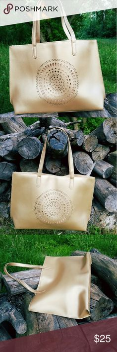 Neiman  Marcus tote Flawless relatively like new condition. Good size tote for multi use. In gold color, with midde circular pattern. Neiman Marcus Bags Totes