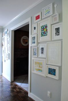 I want to do  a gallery wall like this one.  I always thought black frames but now I am thinking white.