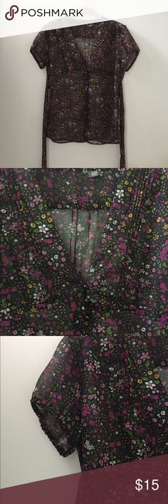 Sheer Floral Top Tag was removed so not sure of the brand but this sheer Floral blouse is in great condition. Short sleeve with elastic to create a poof look. Tie in the back, buttons in the front. Likely not true vintage Vintage Tops Blouses