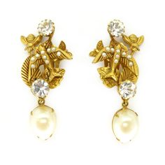 A fabulous pair of Askew earrings with a lovely nature theme to them. The earrings feature gold tone swallows set with small faux pearls with bees... Delfina delettrez?