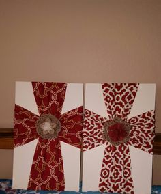 """Fabric crosses on painted wood.  Vertical piece is 6"""" wide and horizontal piece is 8"""" wide.  Flowers are hot glued on."""
