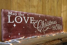 "rustic christmas wall decor. May the love of Christmas fill this home! Beautiful wood piece to put above the fireplace or mantel! This is a long wood sign that measures 48"" x 10"". The background is Tuscan Red. Lettering is White. This piece is handpainted and sanded for a distressed/vintage look. It is then sealed with a water based finish. The back is left unfinished and comes ready to hang."