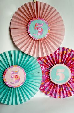 Fold up these paper fans for easy and fun birthday decor! From ThinkCrafts.com