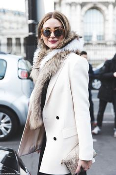 Olivia Palermo in cream jacket with fur scarf. See more at www.herstyledview.com