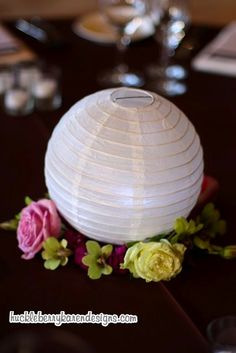Wedding reception, celebration and decoration idea! You can use paper lanterns in several ways. This one is one of our favorite! table top candle holder lantern. #wedding #tips