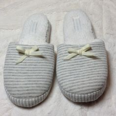 Victoria's Secret Slippers NWOT Grey striped 100% cotton slippers. No tag but plastic cord still holding slippers together. Never worn. Size medium. Machine washable. Victoria's Secret Shoes Slippers