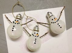 Snowman ornaments made from old lightbulbs