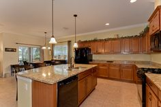 16005 Courtside View Dr Gourmet kitchen with lovely maple cabinets topped with crown, large island, walk-in pantry & HUGE eat-in area!
