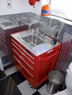 Great garage sink idea: possible firehouse/firefighter-themed man cave bathroom vanity made from a red tool box and accented with a diamond plate back splash