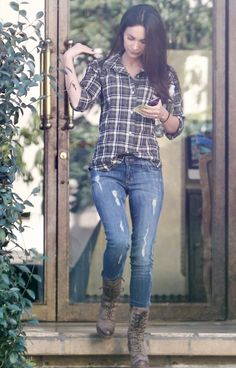 Checkered shirt, jeans and combat boots. Megan Fox.