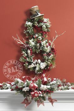 Snowman Wreath Christmas Mantel Display created by RAZ Imports using the new 2013 Burlap Top Hat, arriving this summer to www.trendytree.com See more from the RAZ Tiny Tannenbaums collection at Trendy Tree!