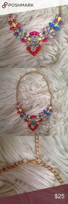 Statement crystal floral jewel necklace w e l c o m e  t o  m y  c l o s e t    gotta let them have it! Awesome statement crystal floral necklace with lobster clasp. Approx 11.5in at widest point. NWOT.  All reasonable offers welcomed.                    question/unsure? let's talk.                    Thanks for looking👀, liking👍, and sharing💕 Jewelry Necklaces