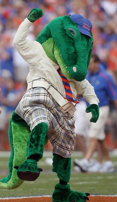 Florida mascot 'Albert' gets the crowd going with the 'Two Bits' cheer before the start of their game against Troy at Ben Hill Griffin Stadium in Gainesville, Fla.